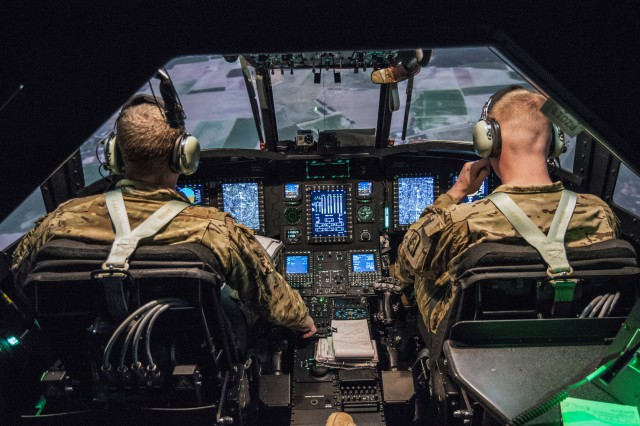 Maintenance technician Chief Warrant Officer 3 Adam M. Marshall and instructor pilot Chief Warrant Officer 2 Stanley G. Yeadon conduct annual CH-47 flight simulator training in Illesheim, Germany Jan. 25, 2017.