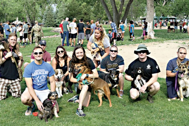 """Roughly 500 Soldiers from the 2nd Infantry Brigade Combat Team, 4th Infantry Division, Family members and friends gather for the """"Walk to Kosovo/Afghanistan"""" at Iron Horse Park June 15, 2018. (Photo by Staff Sgt. Leah Kilpatrick)"""