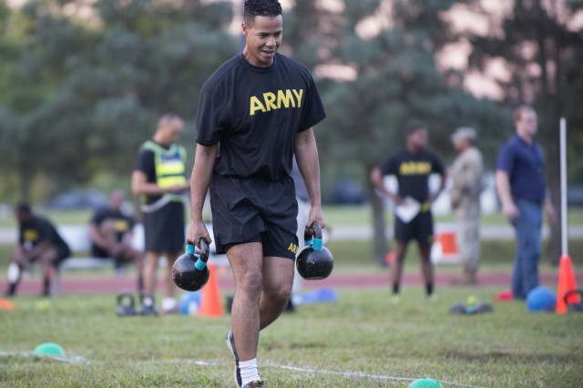 A Soldier carries two 40-pound kettlebell weights during a pilot for the Army Combat Fitness Test, a six-event assessment designed to reduce injuries and replace the current Army Physical Fitness Test.