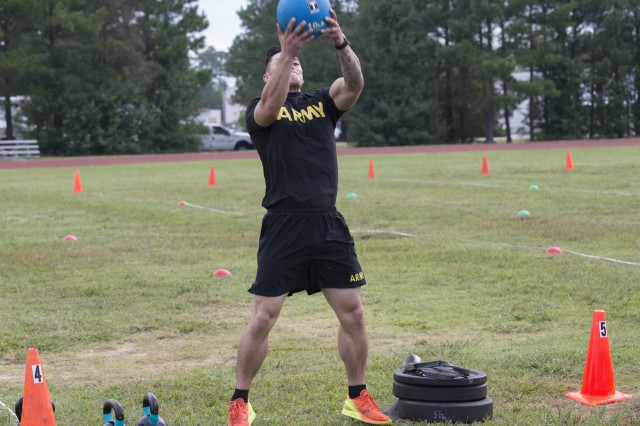 Staff Sgt. Joel Demillo demonstrates the standing power throw event during a pilot for the Army Combat Fitness Test, a six-event assessment designed to reduce injuries and replace the current Army Physical Fitness Test.