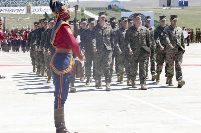 U.S. Marine Corps Pacific Marines march past the reviewing stand at the Khaan Quest 2018 closing ceremony at Five Hills Training Area, Mongolia, June 28.  KQ18 is a multinational training exercise designed to strengthen the capabilities of U.S., Mongolian and other partner nations in international peace support operations.  (U.S. Army National Guard photo by Pfc. Grace Nechanicky/Released)