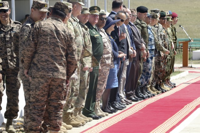 Distinguished visitors line up to greet Ukhnaagiin Khurelsukh, Mongolian Prime Minister, at the Khaan Quest 2018 Closing Ceremony at Five Hills Training Area, Mongolia, June 28.  KQ18 is a multinational training exercise designed to strengthen the capabilities of U.S., Mongolian and other partner nations in international peace support operations.  (U.S. Army National Guard photo by Pfc. Grace Nechanicky/Released)