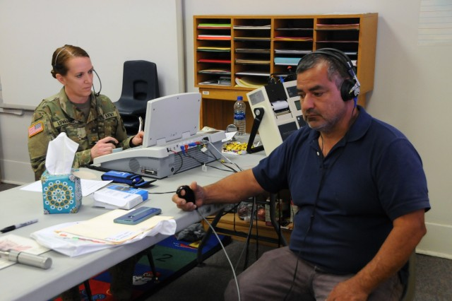 Maj. Sheri Loveland, an Army Reserve audiologist assigned to 7451st Medical Backfill Bn. based out of Joint Base Lewis-McChord, Washington, tests a patient's hearing during his audio screening at Escontrias Early Childhood Center in Socorro, Texas.  Loveland is one of approximately 50 U.S. Army Reserve and U.S. Army Soldiers who are working in partnership with the Texas A&M Colonias program to provide medical care to El Paso County's underserved colonias population. Services provided by military personnel are done through the Department of Defense's Innovative Readiness Training, a civil-military program that builds mutually beneficial partnerships between U.S. communities and the DoD. The missions selected meet training & readiness requirements for Army Reserve service members while integrating them as a joint and whole-of-society team to serve our American citizens.