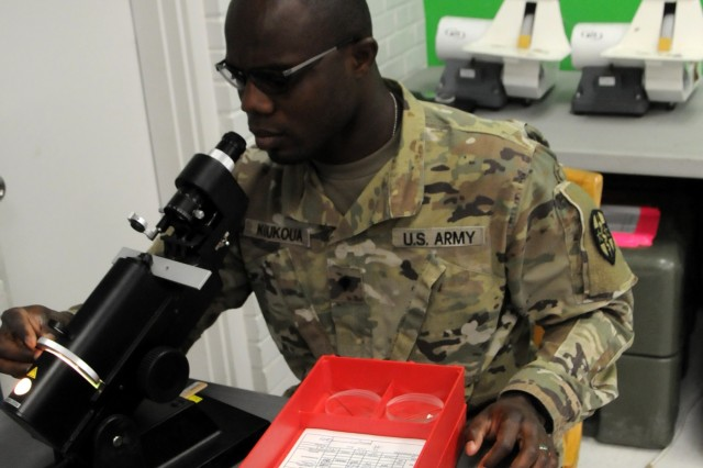 Spc. Kodjo Koukoua, an Army Reserve optical laboratory specialist assigned to 7252nd Medical Support Unit, is processing new eye prescriptions for eyeglass fabrication at Escontrias Early Childhood Center in Socorro, Texas. Koukoua is one of approximately 50 U.S. Army Reserve and U.S. Army Soldiers who are working in partnership with the Texas A&M Colonias program to provide medical care to El Paso County's underserved colonias population. Services provided by military personnel are done through the Department of Defense's Innovative Readiness Training, a civil-military program that builds mutually beneficial partnerships between U.S. communities and the DoD. The missions selected meet training & readiness requirements for Army Reserve service members while integrating them as a joint and whole-of-society team to serve our American citizens.
