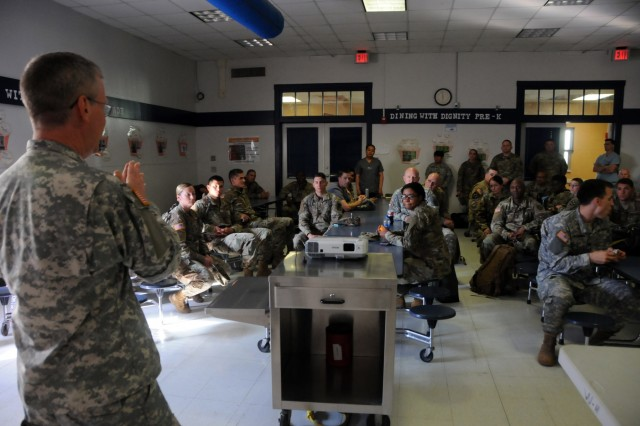 Col. Richard Barrentine, mission commander for 7451st Medical Backfill Bn., conducts an end of day mission briefing with the medical team at Escontrias Early Childhood Center in Socorro, Texas. Barrentine is one of approximately 50 U.S. Army Reserve and U.S. Army Soldiers who are working in partnership with the Texas A&M Colonias program to provide medical care to El Paso County's underserved colonias population. Services provided by military personnel are done through the Department of Defense's Innovative Readiness Training, a civil-military program that builds mutually beneficial partnerships between U.S. communities and the DoD. The missions selected meet training & readiness requirements for Army Reserve service members while integrating them as a joint and whole-of-society team to serve our American citizens.