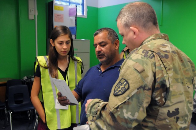 Sgt. 1st Class Joseph Reese and Karina Serrano, a volunteer from Socorro High School Health Professions Academy, assist a patient during an initial eye screening at Escontrias Early Childhood Center in Socorro, Texas.  Reese is one of approximately 50 U.S. Army Reserve and U.S. Army Soldiers who are working in partnership with the Texas A&M Colonias program to provide medical care to El Paso County's underserved colonias population. Services provided by military personnel are done through the Department of Defense's Innovative Readiness Training, a civil-military program that builds mutually beneficial partnerships between U.S. communities and the DoD. The missions selected meet training & readiness requirements for Army Reserve service members while integrating them as a joint and whole-of-society team to serve our American citizens.
