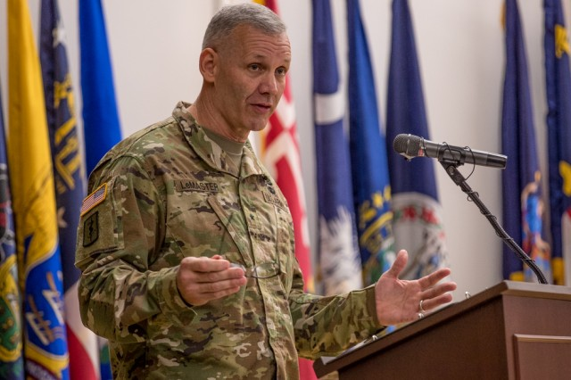 Brig. Gen. Dennis P. LeMaster, commanding general, Regional Health Command-Pacific, provides remarks during Assumption of Responsibility and Uncasing of the Colors Ceremony July 6 at French Theater, Joint Base Lewis-McChord, Washington (U.S. Army Photo by John Wayne Liston).