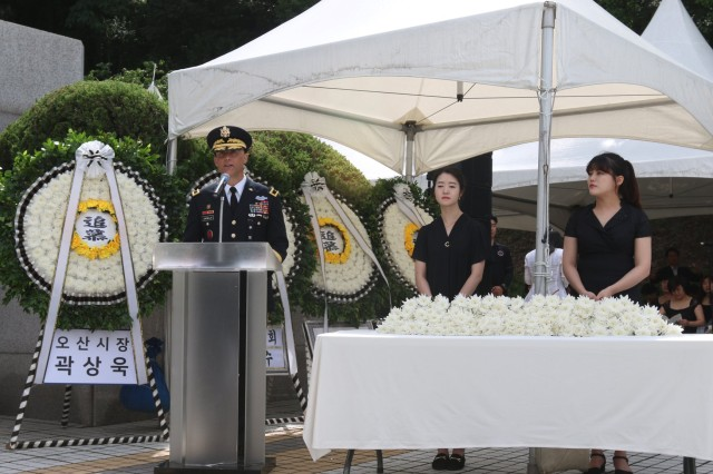 Brigadier Gen. Andrew Juknelis, operational chief of staff, Eighth Army, addresses attendees of the 68th Task Force Smith Memorial Ceremony, July 6. Each year, the city of Osan commemorates the U.S. Soldiers who came to the defense of South Korea, and more specifically, Osan, to block and delay the North's advance as reinforcements were assembled. Inexperienced, understrength and ill-equipped, TF Smith sustained 60 killed, 21 wounded, and 82 captured, during its battle against North Korean forces. Nonetheless, TF Smith delayed the North's advance and reinforcements were eventually able to repel the invasion.