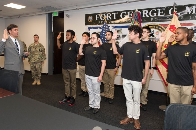 Secretary of the Army Dr. Mark T. Esper swears in new recruits at the Baltimore MEPS station at Fort George G. Meade, July 6, 2018.