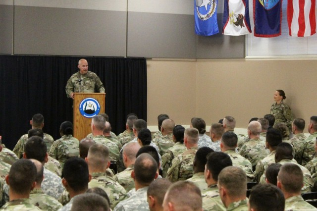 Command Sgt. Maj. Rafael Conde, 32nd Infantry Brigade Combat Team command sergeant major with the Wisconsin National Guard, speaks to students and staff of Fort McCoy Noncommissioned Officer (NCO) Academy during a graduation ceremony for the Basic Leadership Course (BLC) on June 22, 2018, at Fort McCoy, Wis. The graduating class was the first to complete a new BLC curriculum that provided more emphasis on six leader core competencies, including readiness, leadership, training management, communications, operations, and program management. The NCO Academy was activated at Fort McCoy in 1988. The academy is one of the largest tenant organizations at the installation providing institutional training with more than 1,800 students attending annually for the Battle Staff Noncommissioned Officer Course and BLC. (U.S. Army Photo by Scott T. Sturkol, Public Affairs Office, Fort McCoy, Wis.)