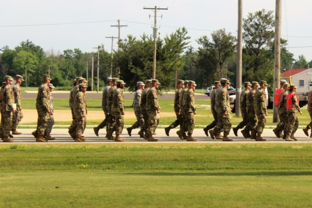 Students at the Fort McCoy Noncommissioned Officer (NCO) Academy march along a roadway during Basic Leadership Course (BLC) operations June 22, 2018, at Fort McCoy, Wis. The graduating class was the first to complete a new BLC curriculum that provided more emphasis on six leader core competencies, including readiness, leadership, training management, communications, operations, and program management. The NCO Academy was activated at Fort McCoy in 1988. The academy is one of the largest tenant organizations at the installation providing institutional training with more than 1,800 students attending annually for the Battle Staff Noncommissioned Officer Course and BLC. (U.S. Army Photo by Scott T. Sturkol, Public Affairs Office, Fort McCoy, Wis.)