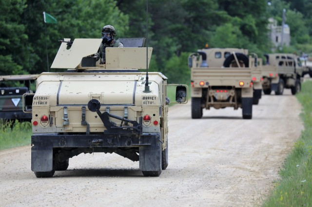 Soldiers participate in a training scenario on a convoy lane on South Post for the 86th Training Division's Combat Support Training Exercise (CSTX) 86-18-04 on June 20, 2018, at Fort McCoy, Wis. More than 6,000 troops from across the United States are training in the exercise, according to the 86th. The exercise is part of the Army Reserve's Combat Support Training Program, or CSTP. CSTP exercises are large-scale, collective-training exercises designed to immerse units into tactical training environments that closely replicate what they might experience in operational deployments. The 86th Training Division is a tenant organization at Fort McCoy. (U.S. Army Photo by Scott T. Sturkol, Public Affairs Office, Fort McCoy, Wis.)