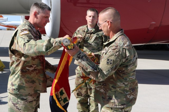 Col. W. Scott Gallaway, commander, 4th Combat Aviation Brigade and Command Sgt. Maj. Marty H. Book prepares the brigade's colors for a casing ceremony June 11 at the Arrival/Departure Control Group. The ceremony signified the brigade's readiness to deploy to Europe. (Photo by Sgt. Daphney Black)