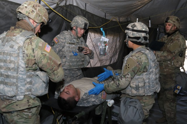 "Soldiers from 4th Attack Reconnaissance Battalion, 4th Aviation Regiment, 4th Combat Aviation Brigade, treat a  simulated casualty during ""Operation Eagle Strike"" Feb. 22, 2018, at Piñon Canyon Maneuver Site. (Photo by Sgt. Daphney Black, Public Affairs Specialist)"