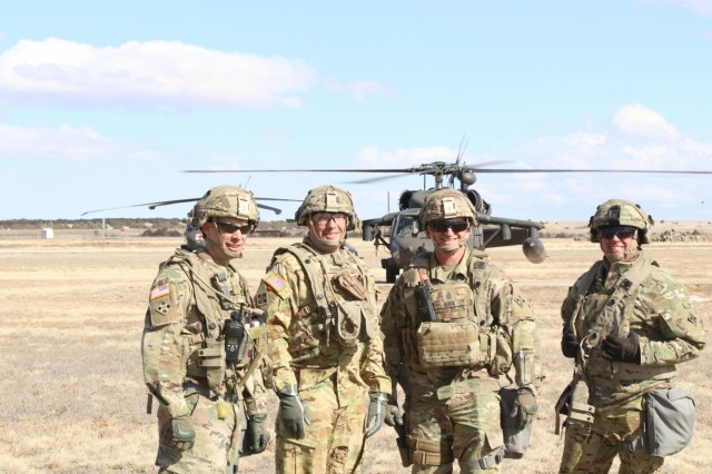 Leaders of 4th combat Aviation Brigade, pose for a group photo at Piñon Canyon Maneuver Site (PCMS) Feb. 22, 2018. (Photo by Sgt. Daphney Black, Public Affairs Specialist)