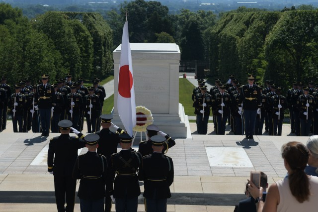 Gen. Koji Yamazaki, chief of staff, Japan Ground Self-Defense Force renders honors during an Army Full Honors Wreath-Laying ceremony at the Tomb of the Unknown Soldier in Arlington National Cemetery, Virginia. (U.S. Army photo by Cory Hancock, JFHQ-NCR/MDW Public Affairs)