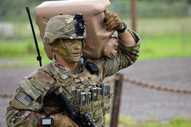 """Maj. Benjamin Horner, assigned to the 3rd Infantry Brigade Combat Team, """"Broncos,"""" 25th Infantry Division, arrives to his first destination as part of a Mungadai exercise April 17 at Schofield Barracks, Hawaii. The Mungadai is used as a Bronco Brigade leader development program is to create disciplined, trained, and ready professionals, prepared with operational and foundational knowledge, to take disciplined initiative while implementing and executing their commander's intent"""