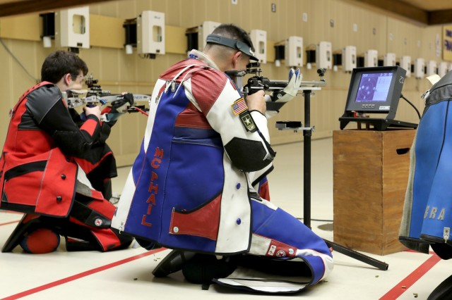 Sgt. 1st Class Michael McPhail, with the U.S. Army Marksmanship Unit's International Rifle Team, fires in the kneeling position during a Men's 3-Position Rifle Match at the Robert Mitchell Rifle Championships in Colorado Springs, Colorado Feb 21, 2018. The former Prone specialist claimed the Bronze Medal at the end of the week-long competition. McPhail, a Darlington, Wisconsin native, competed in the 2016 Rio Olympics and has been a part of the Army's unique marksmanship unit for 14 years. (U.S. Army photo by Michelle Lunato/released)