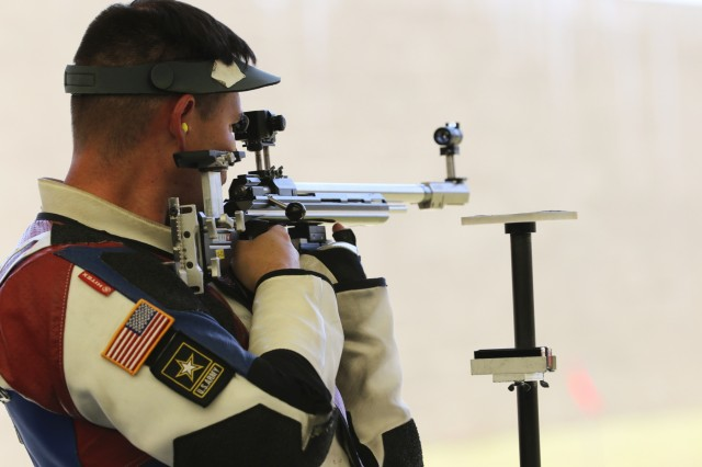 Sgt. 1st Class Michael McPhail, with the U.S. Army Marksmanship Unit's International Rifle Team, fires in the standing position during the 2018 Spring Selection at Fort Benning, Georgia April 1. The Soldier claimed the Silver Medal in the Men's 3-Position Rifle category with a score of 2353. 2016. McPhail, a Darlington, Wisconsin native, competed in the 2016 Rio Olympics and has been a part of the Army's unique marksmanship unit for 14 years. (U.S. Army photo by Michelle Lunato/released)