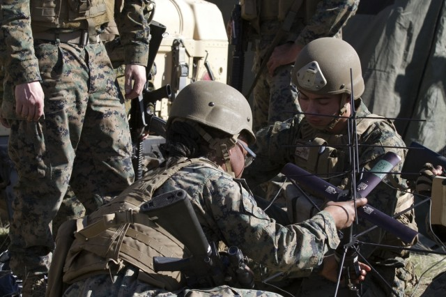 U.S. Marines from the 1st Air Naval Gunfire Liaison Company, 1st Marine Expeditionary Force, during exercise #BayonetFocus 18-02 at set up a communications satellite on Camp Roberts, Calif., Feb. 7, 2018. The exercise allows Marines and Soldiers to build cohesion and develop a shared understanding of capabilities and limitations in an aggressive and complex threat environment.  Marines from the 1st ANGLICO provide commanders a liaison capability to plan, coordinate, and conduct terminal control of fires in support of joint, allied, and coalition forces.  (U.S. Army photo by Staff Sergeant Kenneth G. Pawlak, 7th Infantry Division)