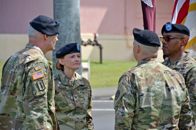 (From left to right) Brig. Gen. Dennis P. LeMaster, commanding general, Regional Health Command - Pacific, Col. Mary V. Krueger, Tripler Army Medical Center (TAMC) incoming commander, TAMC Command Sgt. Maj. Abuoh E. Neufville, and Col. Andrew M. Barr, TAMC outgoing commander, members of the official party during a change of command ceremony, on July 10, conduct the ceremonial passing of the colors at the hospital's main entrance to signify the transfer of command authority and responsibility from the outgoing commander to the incoming commander. With the transfer of colors, the hospital's legacy is passed as a building block for future achievement. With the transfer of the colors, goes the transfer of responsibility for the accomplishments of the unit and the welfare of its soldiers and their families. Now as the 55th commander of Tripler Army Medical Center, Krueger completed her first action in command during the ceremonial passing of the colors as she passed the colors to Command Sgt. Maj. Abuoh E. Neufville, Tripler Army Medical Center's most senior enlisted advisor. (U.S. Army photo by Leanne Thomas)