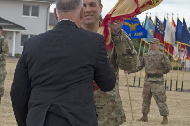 Michael Formica, IMCOM-E director, presents the garrison colors to Col. Noah C. Cloud.