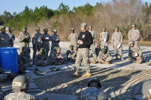 U.S. Army Sgt. 1st Class Dustin Knapp (center), instructs a class at the air assault school at Fort Benning, Georgia in 2012. Knapp is one of few U.S. Army medics who have earned a the prestigious black hat, headgear worn only by an Army special schools instructor, for both the air assault and pathfinder schools.