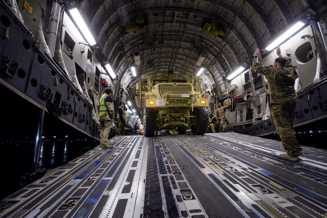 A Mine-resistant, ambush protected (MRAP) vehicle is loaded onto a C-17 Globemaster III at Bagram Airfield, Afghanistan, March 14, 2018.