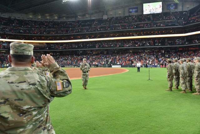 13th ESC Commanding General reenlists 100 Soldiers before Astros Game