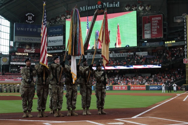 The 13th Expeditionary Sustainment Command Color Guard presents the Colors at Minute Made Park during a mass re-enlistment of III Corps Soldiers before a Houston Astros baseball game on July 5, 2018.