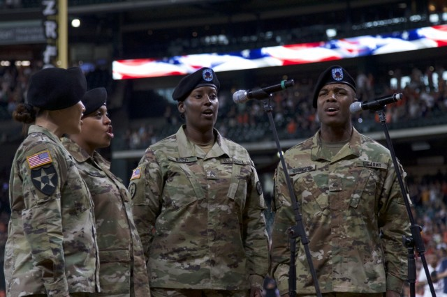 A Quartet of Soldiers from the 13th Expeditionary Sustainment Command sing the National Anthem at Minute Made Park during a mass re-enlistment of III Corps Soldiers before a Houston Astros baseball game on July 5, 2018.