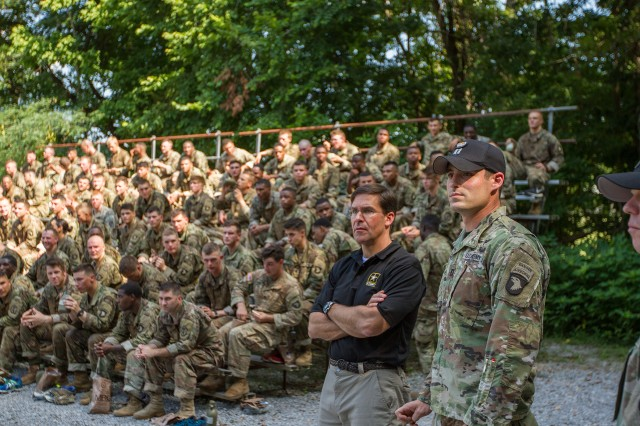 The Secretary of the Army, Dr. Mark T. Esper, observes Soldiers as they maneuver through the air assault obstacle course at The Sabalauski Air Assault School at Fort Campbell, Kentucky, July 10, 2018. The 101st Airborne Division (Air Assault) is the Army's only air assault division.