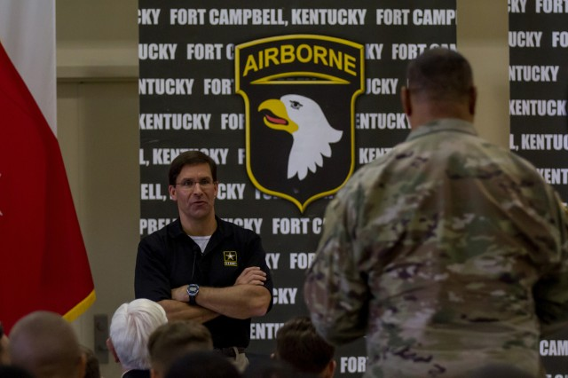 The Secretary of the Army, Dr. Mark T. Esper, receives a question from a Soldier during a town hall meeting on Fort Campbell, Kentucky, July 10, 2018.