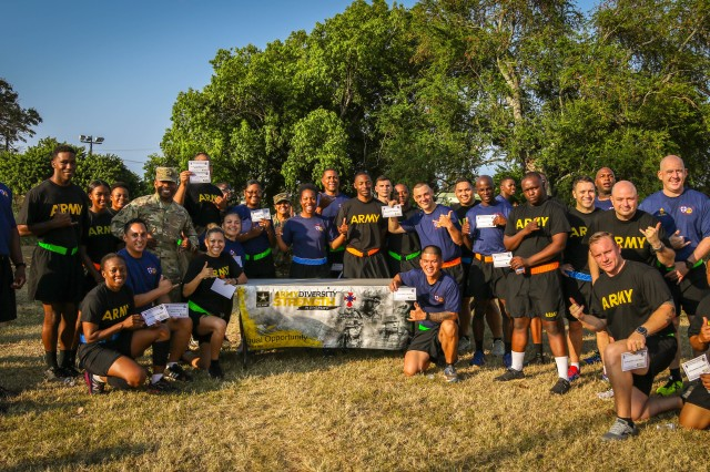 Winners of the Headquarters and Headquarters Company, 8th Special Troops Battalion, 8th Theater Sustainment Command,   Equal Opportunity Scavenger Hunt show off their prizes on Fort Shafter, Hi., July 2, 2018. The winners of the scavenger hunt received a 3 day pass for the 4th of July weekend. (U.S. Army photo by Spc. Geordan Tyquiengco)