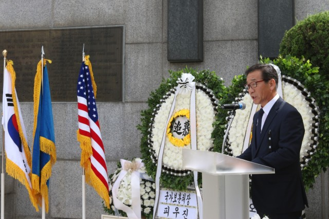 OSAN, Republic of Korea - Lee Jae-myung, governor of Gyeonggi Province, addresses attendees of the 68th Task Force Smith Memorial Ceremony, July 6. Each year, the city of Osan commemorates the U.S. Soldiers who came to the defense of South Korea, and more specifically, Osan, to block and delay the North's advance as reinforcements were assembled. Inexperienced, understrength and ill-equipped, TF Smith sustained 60 killed, 21 wounded, and 82 captured, during its battle against North Korean forces. Nonetheless, TF Smith delayed the North's advance and reinforcements were eventually able to repel the invasion. (Photo by Staff Sgt. Todd Pouliot, 35th Air Defense Artillery Brigade)