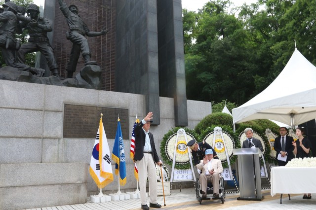 OSAN, Republic of Korea - U.S. Army Corporals Raymond Mellin and William Coe, members of Task Force Smith, acknowledge attendees of the 68th Task Force Smith Memorial Ceremony, July 6. Each year, the city of Osan commemorates the U.S. Soldiers who came to the defense of South Korea, and more specifically, Osan, to block and delay the North's advance as reinforcements were assembled. Inexperienced, understrength and ill-equipped, TF Smith sustained 60 killed, 21 wounded, and 82 captured, during its battle against North Korean forces. Nonetheless, TF Smith delayed the North's advance and reinforcements were eventually able to repel the invasion. (Photo by Staff Sgt. Todd Pouliot, 35th Air Defense Artillery Brigade)