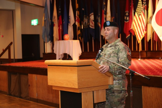 Col. Phillip Gage, USAG Japan commander, thanks outgoing Command Sgt. Maj. Will Holland for his outstanding service during Holland's relinquishment of responsibility ceremony July 11, 2018, at Camp Zama's Community Club. Holland, and his wife, Wendy, are headed to the next assignment in Washington, D.C. (U.S. Army photo by Noriko Kudo)
