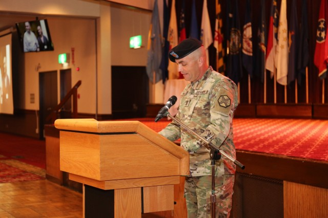 Command Sgt. Maj. Will Holland, outgoing command sergeant major for U.S. Army Garrison Japan, thanks community members for their support during Holland's relinquishment of responsibility ceremony July 11, 2018, at Camp Zama's Community Club. (U.S. Army photo by Noriko Kudo)