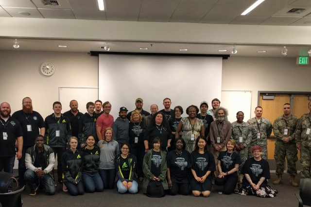 Soldiers from 56th Theater Information Operations Group, Joint Force Headquarters, and Headquarters and Headquarters Company, 181st Brigade Support Battalion, 81st Stryker Brigade Combat Team, pose with participants of International Collegiate Cyber Defense Invitational, July 6, 2018, at Highline Community College in Des Moines, Wash.