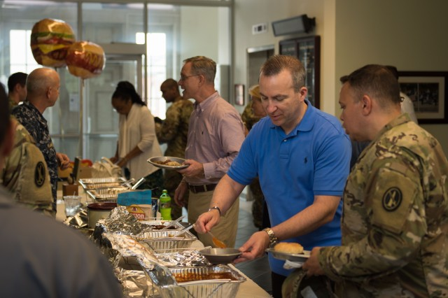 Service members and civilians, with Joint Force Headquarters - National Capital Region and U.S. Army Military District of Washington, come together during a Chili Cook-out fundraiser, on Fort McNair, Washington, D.C., July 11, 2018. The fundraiser was in support to the JFHQ-NCR/MDW Organizational Day, slated for August 10, which will bring service members, civilians and their families together to mingle, relax and participate in a variety of wholesome, recreational activities. (U.S. Army photos by Sgt. Nicholas T. Holmes)