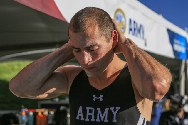 Army Staff Sgt. Shawn Runnels, Team Army Competitor, applies sunscreen before the DoD Warrior Games, Colorado Springs, Colorado last month. Blanchfield Army Community Hospital, Chief of Dermatology, Maj. Michael Digby recommends applying a broad spectrum sunscreen with an SPF 30 every two hours when out in the sun. Sunscreen should be reapplied every thirty minutes when swimming or excessively sweating outdoors.  (U.S. Army photo by Pfc. Julie Driver)
