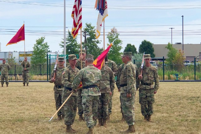 In a ceremony at Detroit Arsenal July 12, 2018, Gen. Gustave F. Perna, Army Materiel Command commanding general, passes the U.S. Army Tank-automotive and Armaments Command unit flag to Maj. Gen. Daniel G. Mitchell to symbolize the transfer of leadership to Mitchell from Maj. Gen. Clark W. LeMasters Jr.