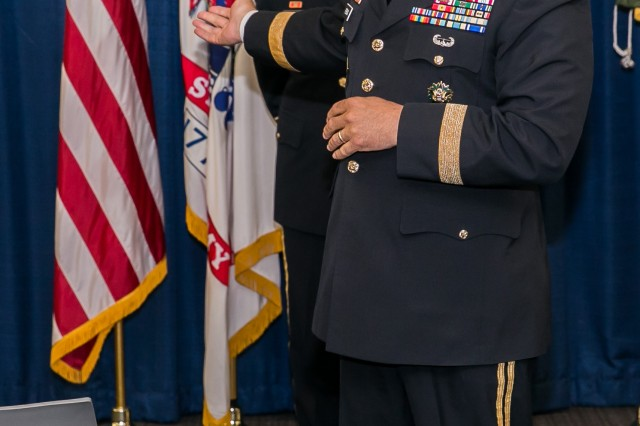 Gen. Gus Perna, U.S. Army Materiel Command commander, tells a funny story about Maj. Gen. Paul Pardew during Pardew's promotion ceremony. Pardew is the commander of the U.S. Army Contracting Command.