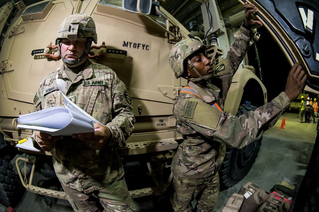 Soldiers assigned to the 155th Armored Brigade Combat Team conduct a Preventative Maintenance Checks and Services (PMCS) inspection on an M-ATV Mine-Resistant Ambush Protected (MRAP) vehicle at an Army Prepositioned Stocks-5 warehouse, June 24, at Camp Arifjan, Kuwait. The vehicle is part of APS-5's ABCT equipment set. APS-5 is managed and maintained by the 401st Army Field Support Brigade. This equipment draw of APS-5's newly configured for combat ABCT marks the largest ever draw from APS-5. (U.S. Army photo by Justin Graff, 401st AFSB Public Affairs)