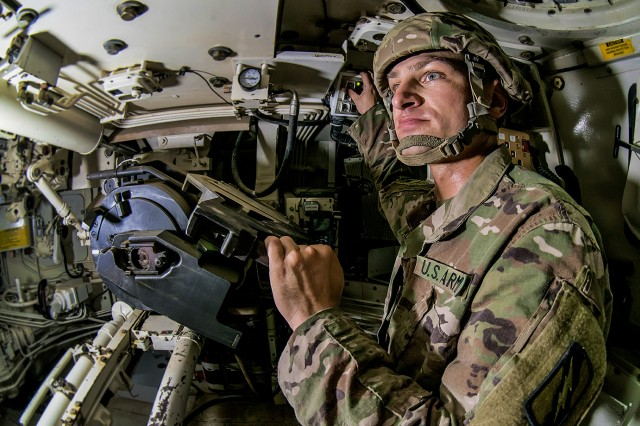 Sgt. Andrew Kopaczewski, a Soldier assigned to C Battery, 2nd Battalion, 114th Field Artillery Regiment, 155th Armored Brigade Combat Team inspects an M109 Paladin at an Army Prepositioned Stocks-5 warehouse during a large-scale equipment issue from APS-5 to the 155th ABCT, July 1, at Camp Arifjan, Kuwait. The vehicle is part of APS-5's ABCT equipment set. APS-5 is managed and maintained by the 401st AFSB. This equipment draw of APS-5's newly configured for combat ABCT marks the largest ever draw from APS-5. (U.S. Army photo by Justin Graff, 401st AFSB Public Affairs)