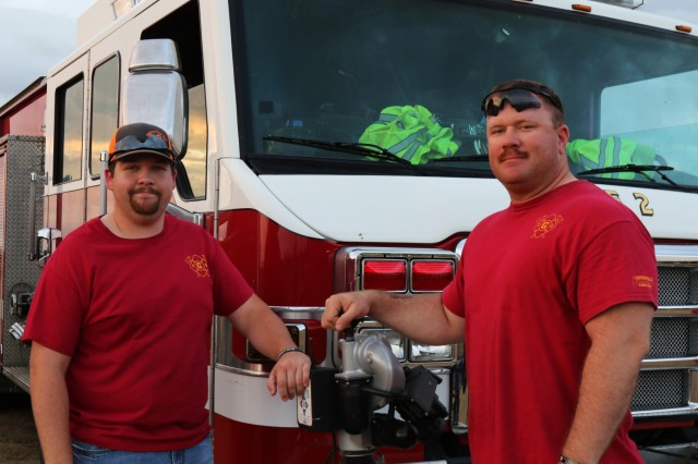 Firefighter Nicholas Brown (Left) and Sgt. 1st Class Michael Bernquist (Right) pose by a fire truck, July 4, 2018, Gatesville, Texas.  Bernquist has been volunteering for the GFD for four years. (U.S. Army photo by Sgt. Melissa N. Lessard)