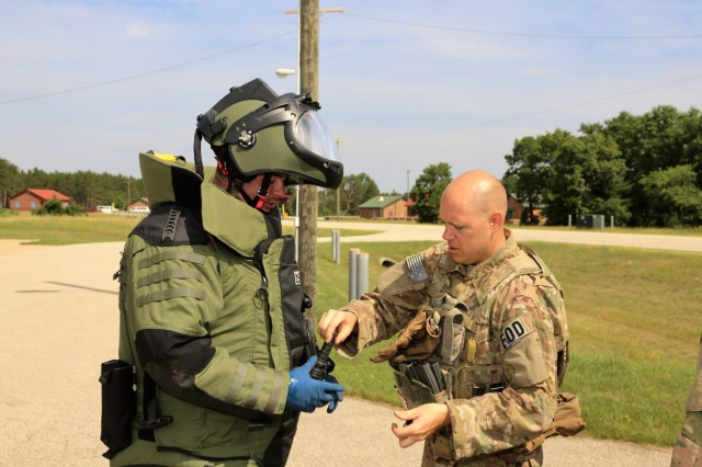 Explosive ordnance disposal Airmen prepare for a training scenario June 22, 2018, at the Combined Arms Collective Training Facility at Fort McCoy, Wis. The training was part of Exercise Audacious Warrior 2018. Nearly 60 Airmen from 10 states as well as teams of international service members who are part of explosive ordnance disposal teams trained at Fort McCoy for 12 days in late June to early July as part of the exercise. Training also took place at Volk Field, Wis. Throughout the training, the EOD Airmen completed scenarios in convoy operations, populated-area responses for IEDs, and more. (U.S. Army Photo by Scott T. Sturkol, Public Affairs Office, Fort McCoy, Wis.)