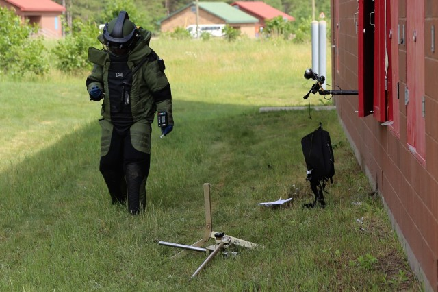An explosive ordnance disposal Airman participates in a training scenario in a full protective suit June 22, 2018, at the Combined Arms Collective Training Facility at Fort McCoy, Wis. The training was part of Exercise Audacious Warrior 2018. Nearly 60 Airmen from 10 states as well as teams of international service members who are part of explosive ordnance disposal teams trained at Fort McCoy for 12 days in late June to early July as part of the exercise. Training also took place at Volk Field, Wis. Throughout the training, the EOD Airmen completed scenarios in convoy operations, populated-area responses for IEDs, and more. (U.S. Army Photo by Scott T. Sturkol, Public Affairs Office, Fort McCoy, Wis.)