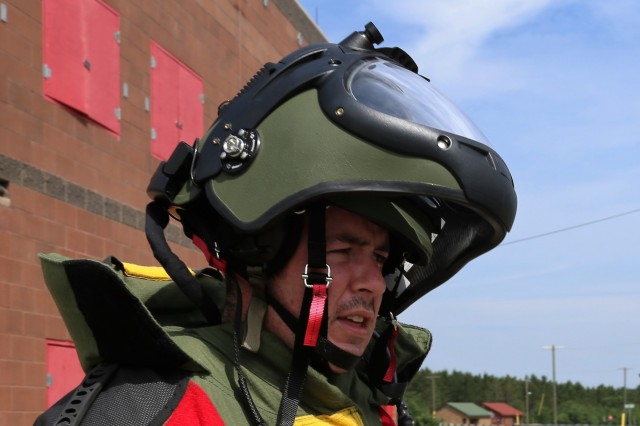 An explosive ordnance disposal Airman prepares for a training scenario June 22, 2018, at the Combined Arms Collective Training Facility at Fort McCoy, Wis. The training was part of Exercise Audacious Warrior 2018. Nearly 60 Airmen from 10 states as well as teams of international service members who are part of explosive ordnance disposal teams trained at Fort McCoy for 12 days in late June to early July as part of the exercise. Training also took place at Volk Field, Wis. Throughout the training, the EOD Airmen completed scenarios in convoy operations, populated-area responses for IEDs, and more. (U.S. Army Photo by Scott T. Sturkol, Public Affairs Office, Fort McCoy, Wis.)