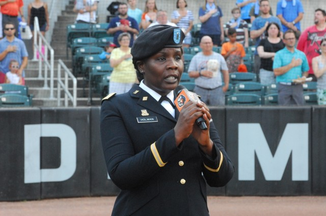 1st Lt. Shavon Holman sings the Star Spangled Banner at the Aberdeen Ironbirds baseball game on July 3. Soldiers from the 20th CBRNE Command represented the Army and Aberdeen Proving Ground at several community events July 1-4.